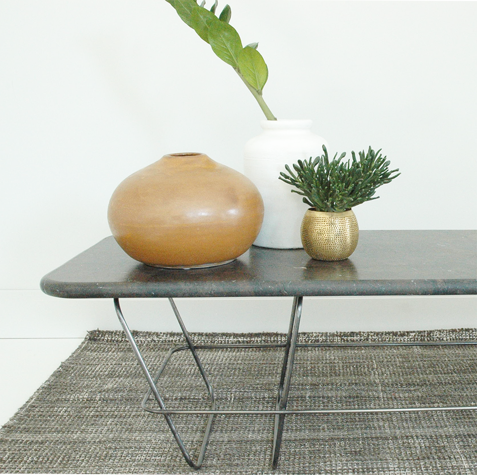 Hand-crafted coffee table, hand-burnished metal feet, Brazilian Brescia marble top.